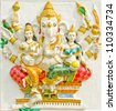 God of success 32 of 32 posture. Indian style or Hindu God Ganesha avatar image in stucco low relief technique with vivid color,Wat Samarn, Chachoengsao,Thailand. - stock photo