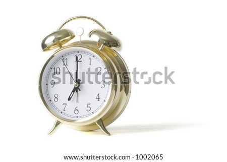 Gold alarm clock isolated on white