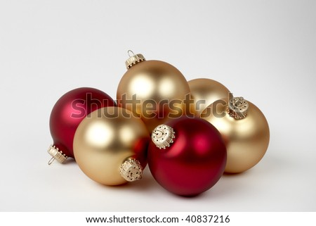 Gold and red Christmas balls with soft shadow shot on white background with space for copy