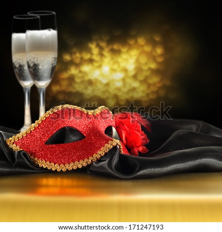 gold bokeh and red mask with champagne