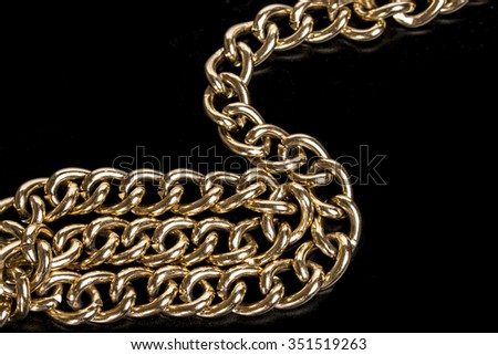 gold chains on a black background