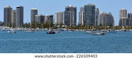 GOLD COAST - OCT 23 2014:Yachts mooring under Surfers Paradise Skyline.It one of Australia's iconic coastal tourist destinations, drawing about 10 million tourists every year from all over the world.