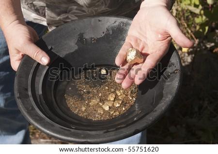 stock-photo-gold-panning-man-striking-it
