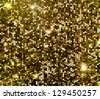 Gold sparkle glitter background. Glittering sequins wall. - stock photo