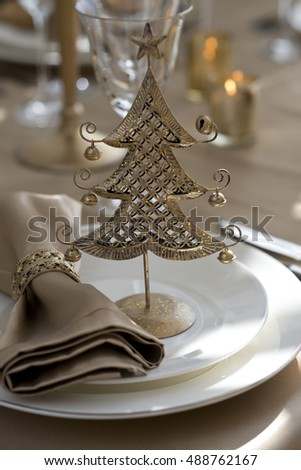 gold table setting for Christmas