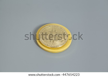 Golden Bitcoin coin isolated on gray background