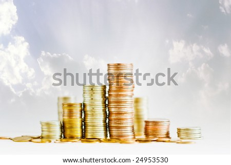 Golden coins isolated on white and blue background