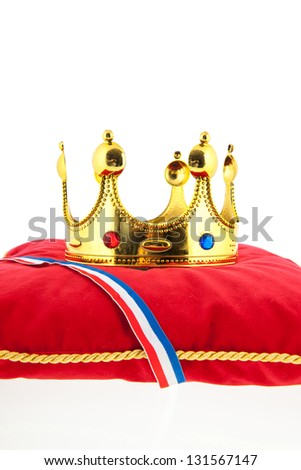 Golden crown on red velvet pillow for coronation in Holland