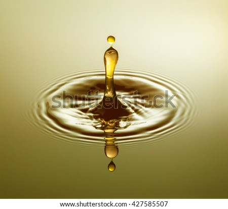 Golden Drop - Water drop photography, one or two drops of water dropped from height into water and captured as they hit the water or collide with each other.