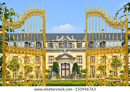 Golden gate at palace of Herrenhausen Gardens, Hannover, Germany. Royal Gardens at Herrenhausen are one of the most distinguished baroque formal gardens of Europe.