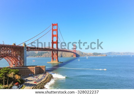 Golden Gate bridge at San Francisco with the clear sky and sailing boat.