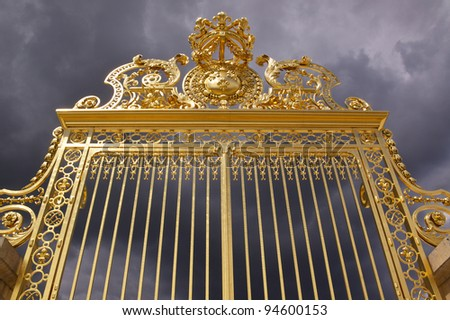 Golden gate of Versailles Palace near Paris moments before the storm