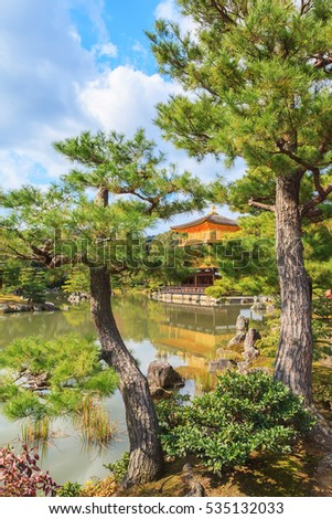 Golden Pavilion Kinkakuji temple against blue sky background in autumn season at Kyoto, Japan