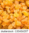 Golden raisins close-up background - stock photo