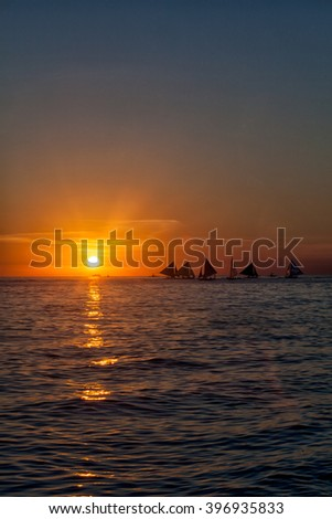 Golden sunset, sailboat in the sea