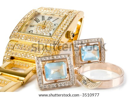 Golden watch and jewelery. Isolated on white.