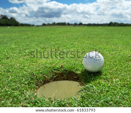 Golf ball at the hole