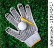 golf ball hand gloves and yellow tee - stock photo