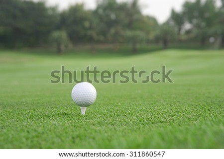 Golf ball on tee,atmosphere morning,There is space on the left and right for adding text.