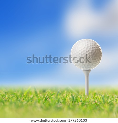 Golf ball on tee in golf course