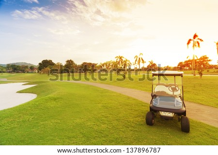 golf car with sun set in golf course.