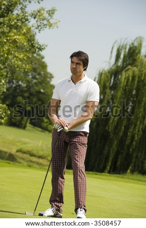 Golf club: golfer concentrating on the next shot