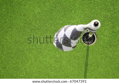 golf hole flag on a field