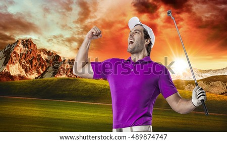 Golf Player in a pink shirt celebrating, on a golf course.