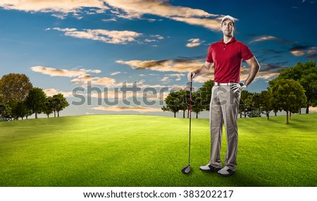 Golf Player in a red shirt standing on a golf course.