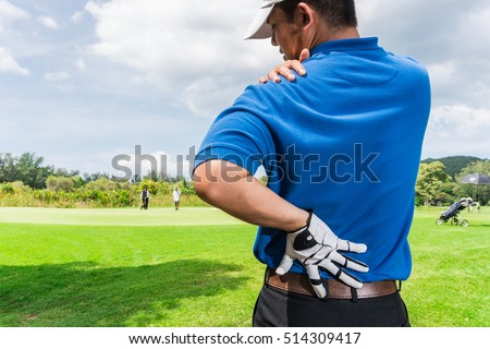 Golfer Back and shoulder pain during the game, muscle injury concept.