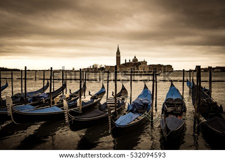 Gondolas in Venice in front of San Giorgio island, Italy, Europe, Sepia filtered style