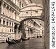 Gondolas passing over Bridge of Sighs - Ponte dei Sospiri.  Unesco world heritage site, Venice,Veneto, Italy, Europe. - stock photo