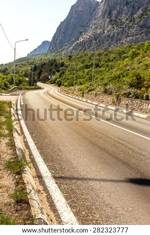 Good asphalted road along the picturesque rocky high mountains in Crimea.