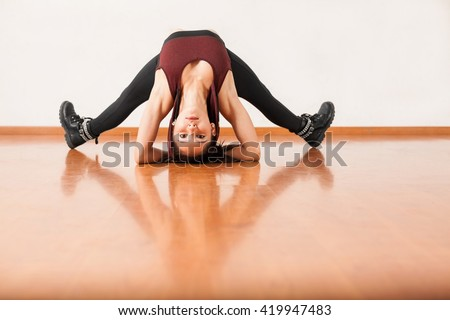 cute young brunette doing some stretching stock photo