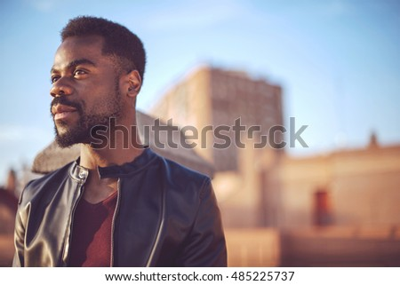 Good looking young black man in trendy clothes with negative space