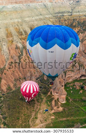 GOREME, TURKEY - APR 15, 2015: The great  balloon flight Cappadocia is known around the world as one of the best places to fly with hot air balloons on April 15,2015 Goreme, Cappadocia, Turkey