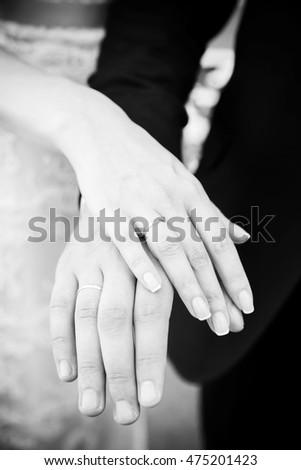 gorgeous couple's hands with wedding rings (black and white)