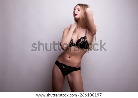 Gorgeous sexy blonde in bikini. Studio shooting. Sexuality and sensuality. Hot body. Perfect shape
