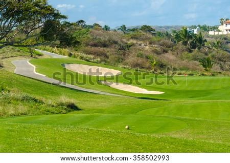 Gorgeous view at the luxury golf course with sand bunker.