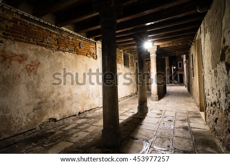 Gothic quarter with old red brick wall at night. Empty alleyways in Venice.