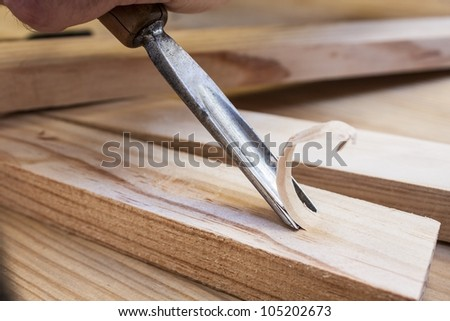 gouge wood chisel carpenter tool working wooden background - stock