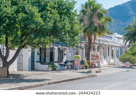 GRAAFF REINET, SOUTH AFRICA - JANUARY 6, 2015: Late afternoon street scene. More than 200 buildings in the town are declared as a national monuments