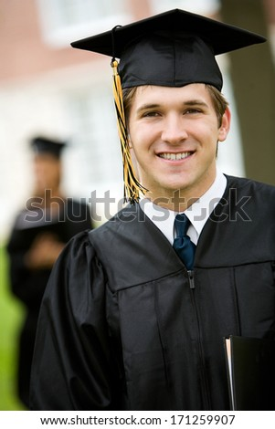 Graduation: Smart Male Student in Cap and Gown