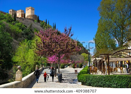 GRANADA, SPAIN - APRIL 12,2016: Paseo de los tristes with a view of Alhambra in the background, Granada, Spain.