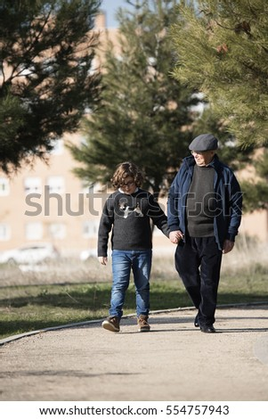 Grandfather caring for his grandson in the park.