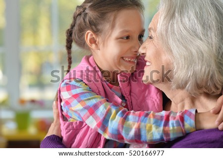 Grandmother and granddaughter hug