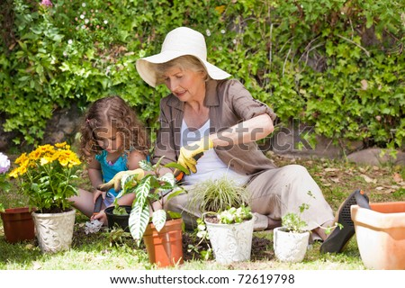 Grandmother and her granddaughter in the garden