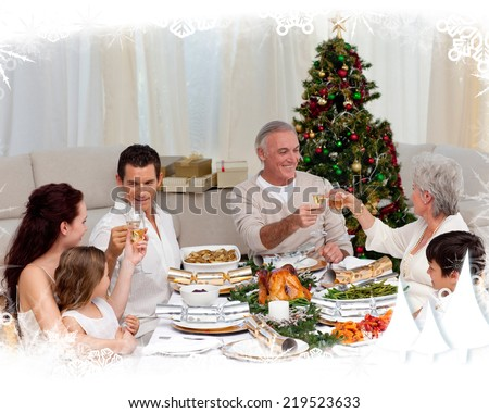 Grandparents and parents toasting in a christmas dinner against frost frame