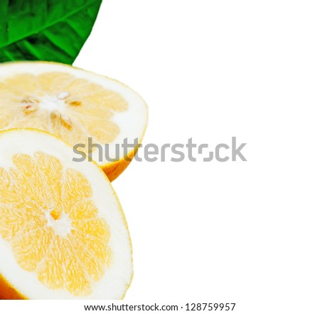 grapefruit cut in half with leaves on white background