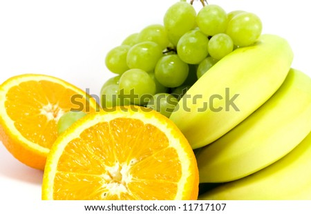 grapes, bananas and two halves of orange close-up